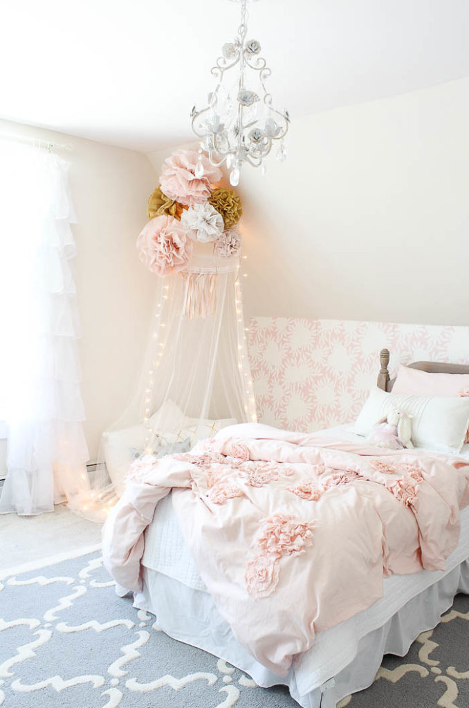 Girls Bedroom with pale pink and a soft blue trellis rug.