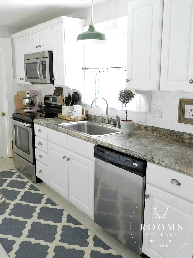 Love this white kitchen with fun farmhouse details kellyelko.com