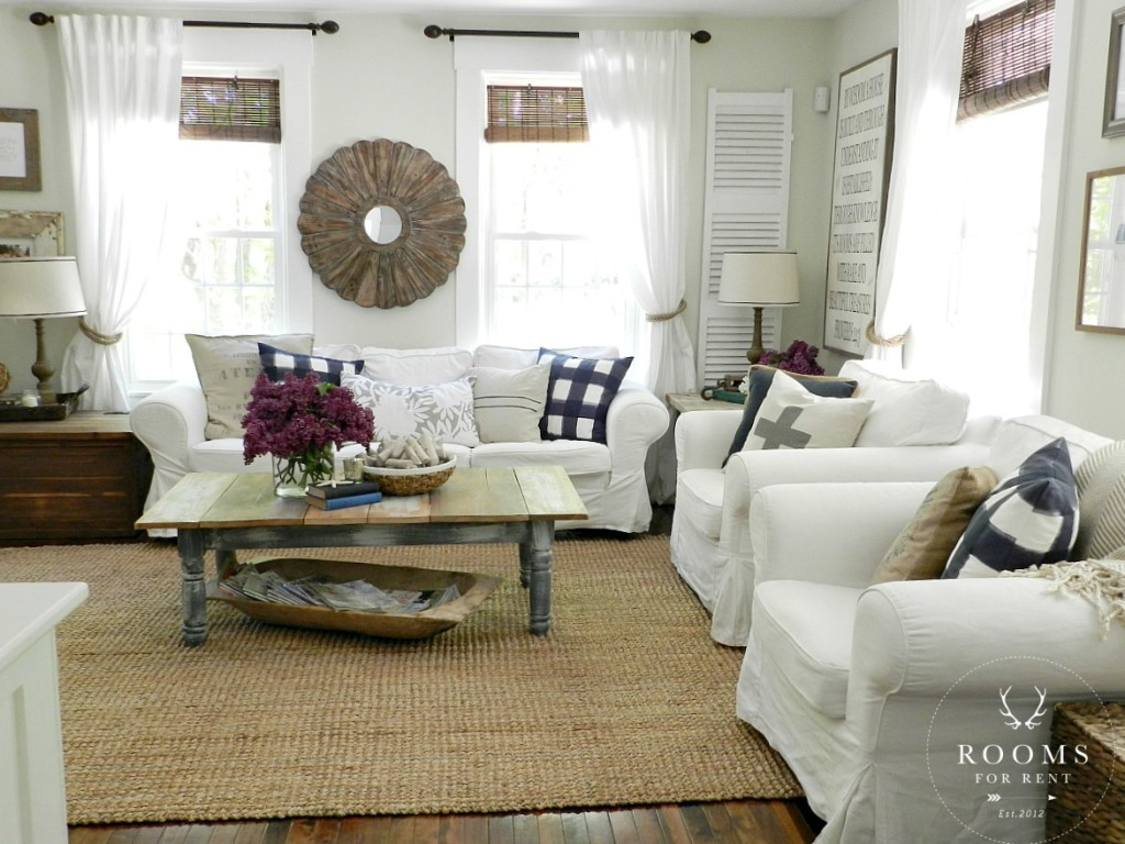 Love this neutral living room - it's so cozy with the white slipcovered furniture kellyelko.com